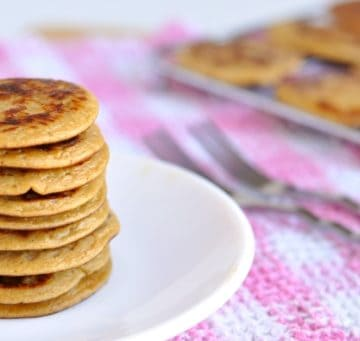 A tower of Healthy Peanut Butter Banana Pancakes on a plate