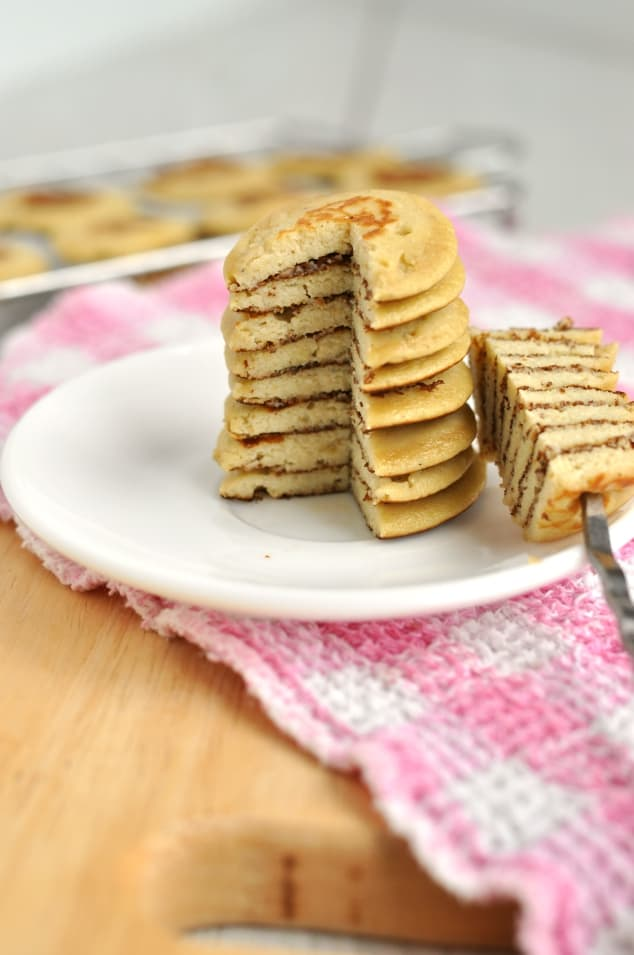 A stack of Healthy 3 Ingredient Banana Pancakes with a slice taken out