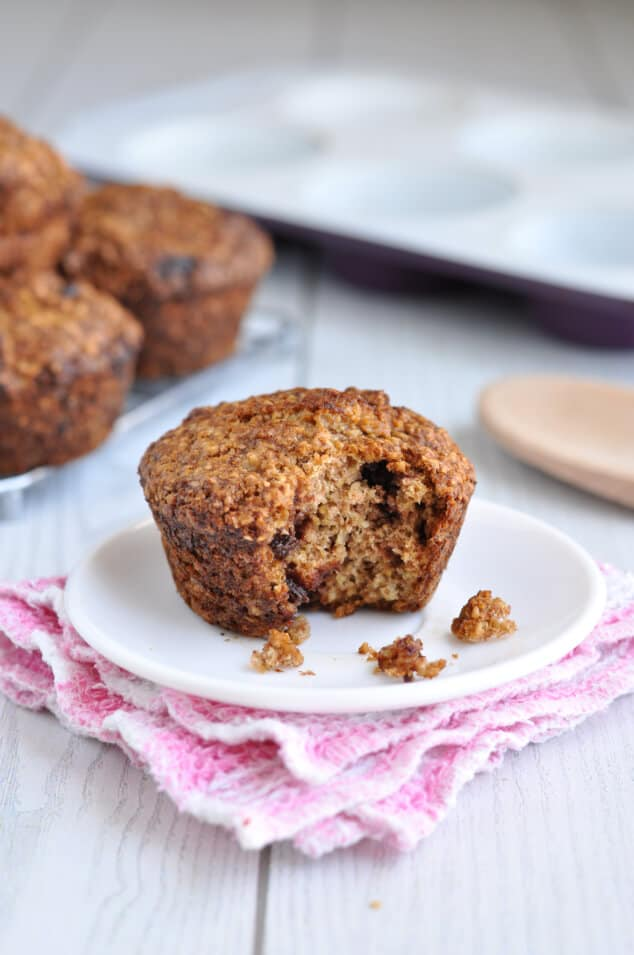 Healthy Oat Bran Muffin with Chocolate Chips with a bite taken out on a plate