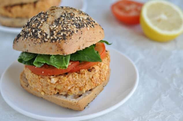A Moroccan Vegan Burger on a plate inside a burger bun