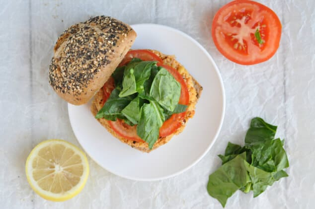 A Moroccan Vegan Burger on a bun topped with spinach