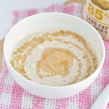 A bowl of peanut butter overnight oats drizzled with honey