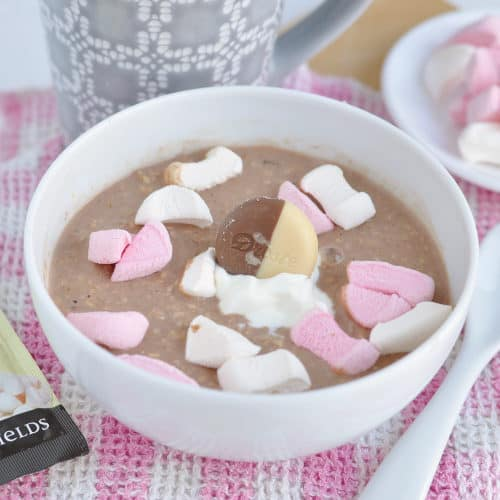A bowl of hot chocolate overnight oats with marshmallows.