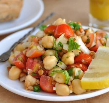 A plate full of lentil chickpea salad.
