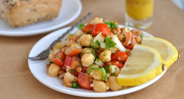 A plate full of lentil chickpea salad.