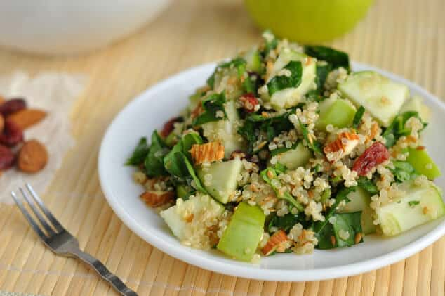 A close-up view of a plate piled high with spinach quinoa salad.