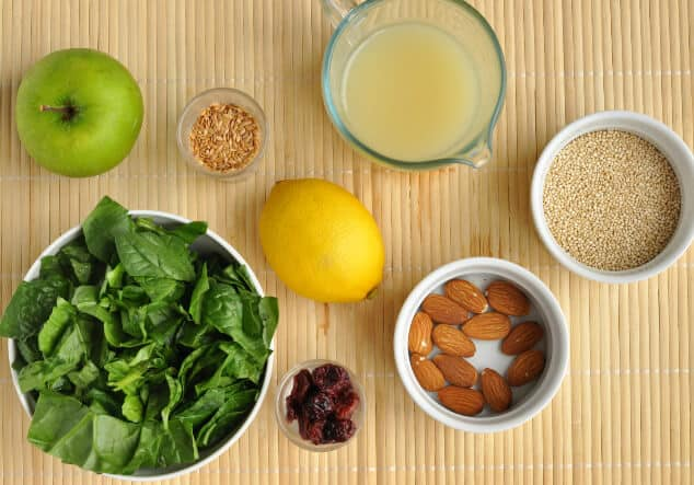 All the ingredients you need to make a spinach quinoa salad.