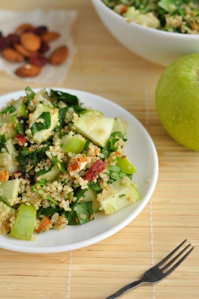 Spinach quinoa salad on a small white plate.